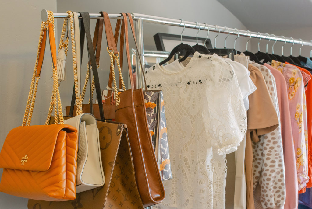 Clothes rack with bags and clothes