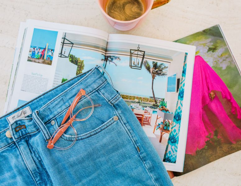 flatlay jeans and magazines